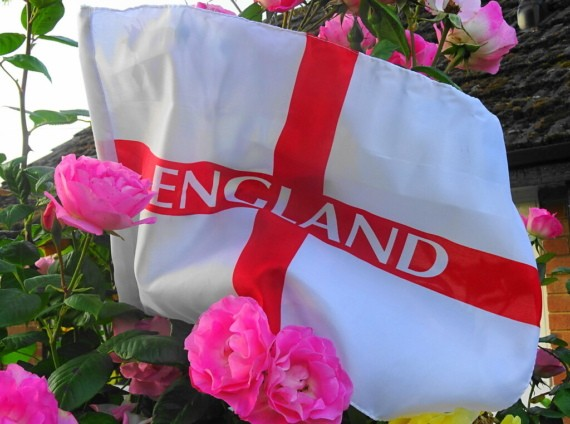 """The flag of St. Geroge with the word """"England"""" written on it surrounded by flowers"""
